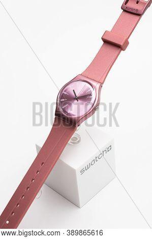 London, Gb 07.10.2020 - Swatch Swiss Made Quartz Watch On Brand Showcase Stand. Stylish Trendy Women