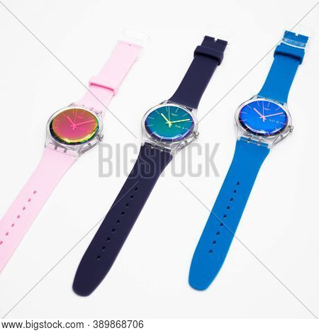 London, Gb 07.10.2020 - Three Swatch Vivid Colorful Trendy Swiss Made Quartz Watch Isolated On White