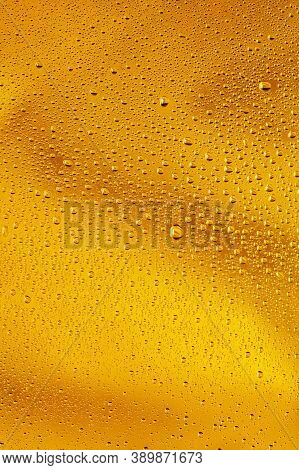 Close Up View Of Cold Drops On The Glass Of Beer Background. Texture Of Cooling Alcohol Drink With M