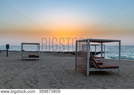 Empty Sandy Beach In Dubai With Double Sun Beds, On New Artificial Bluewaters Island, No People Due