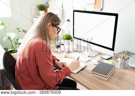Caucasian Woman Working In Her Office And Trying To Write While Suffering From Writer's Block With S