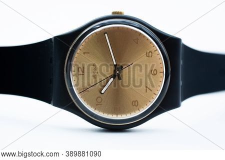 London, Gb 07.10.2020 - Swatch Swiss Made Quartz Watch Isolated On White Background. Beige Dial, Bla