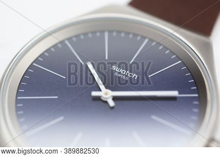 London, Gb 07.10.2020 - Swatch Logo On Blue Wristwatch Dial Of Swiss Made Quartz Watch Isolated On W