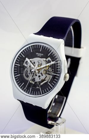 London, Gb 07.10.2020 - Swatch Swiss Made Quartz Watch On Stand Close Up. Plastic Case Open Clock Me