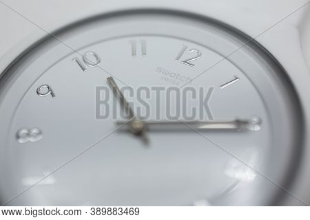London, Gb 07.10.2020 - Swatch Logo On White Wristwatch Dial Of Swiss Made Quartz Watch Isolated On