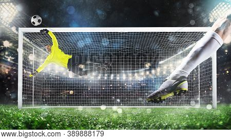 Penalty Kick With The Goalkeeper Trying To Save The Shot With A Dive At The Corner Of The Goalposts