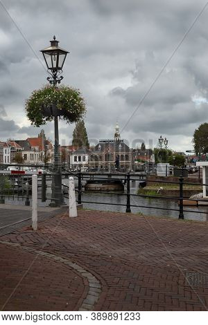 08 October 2020, Leiden, Netherlands, Lamppost With Flowers, Traditional Dutch Facades, Bridges, Shi