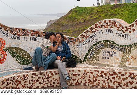 Miraflores, Peru - December 4, 2008: Parque Del Amor, Love Park. Young Kissing Couple On Artful Mosa