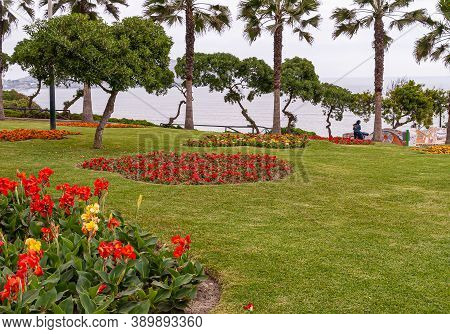Miraflores, Peru - December 4, 2008: Parque Del Amor, Section Of Green Lawn With Mostly Red Flowers