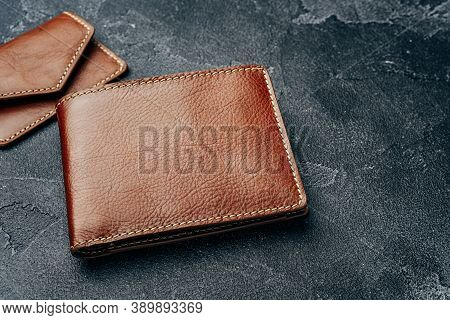 New Brown Leather Wallet On Dark Background