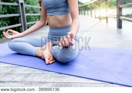 Close Up Images Hand Of Women Are Practicing Yoga In The Basic Position, Which Is A Warm-up And Medi