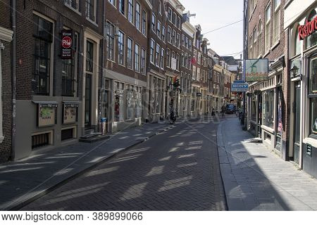 Amsterdam, Holland -10 April 2020: An Empty Zeedijk Street In The Center Of Amsterdam. Normally It I
