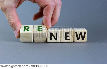 Time To Renew. The Words New And Renew On Wooden Cubes. Male Hand.  Beautiful Grey Background, Copy
