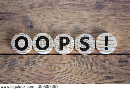 Oops Sign On Wooden Circles. Beautiful Wooden Background, Copy Space. Business Concept.