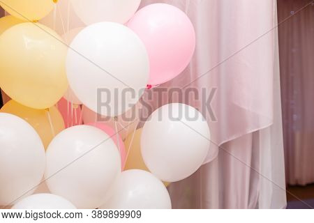 Colorful Balloons, Party Background. Baloons Of Pale Pink, Yellow And White Color. Pink Curtain