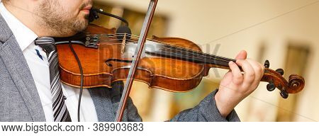 Playing Violin, A Musician Plays Vintage Violin On A Concert, Close Up