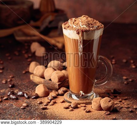Truffles And Glass Of Hot Chocolate With Whipped Cream. Sweets And Drink Sprinkled With Cocoa Powder
