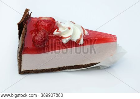Slice Of Strawberry Cheesecake With Jelly And Strawberries. Jelly And Cheese Cake On A Shortbread Ch