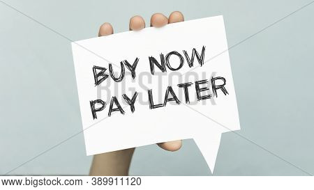 Buy Now Pay Later Text Concept Write On Paper In Hand