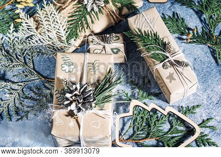 Christmas Presents With Gift Box Decorated With Pine Cones And Twigs On Blue Background, Preparation