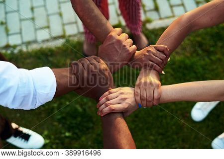 Black People With Hands Joined. Group Of People Stacking Hands Together.