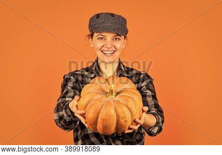 Organic Farming. Family Farm. Woman Rustic Farmer Presenting Pumpkin. Farming And Agriculture. Agric