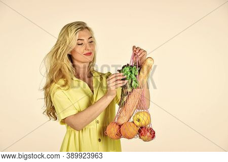 Girl In Dress Carry Bag Shopper. Woman Holding String Shopping Bag With Fruits. Reusable Bag. Grocer