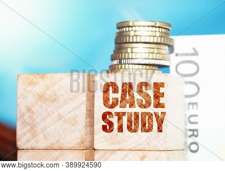 Case Study Word Written On Wood Block. Case Study Text On Table, Concept. Front View Concepts, Coins