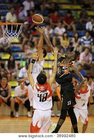KUALA LUMPUR - OCT 28: Firehorse's players (black) and Dragon's players (white) scramble for a loose ball in a Malaysia National Basketball League match on October 28, 2012 in Kuala Lumpur, Malaysia.
