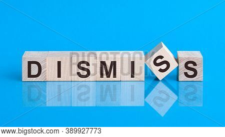 The Text Dismiss Is Written On The Cubes In Black Letters, The Cubes Are Located On A Blue Glass Sur