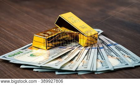Gold Bar On Dollar Bills, Investing In Real Gold Than Gold Bullion. Money And Gold, Financial Concep