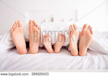 Closeup Photo Of Happy Family Barefoot Mommy Daddy Kid Legs Lying Sheets Sleeping Early Morning Spen