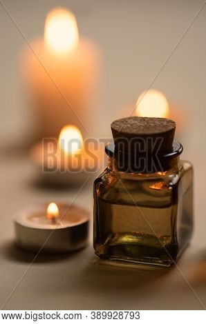 Tranquil And Concise Spa Composition With Oil Flask And Candles. Copy Space