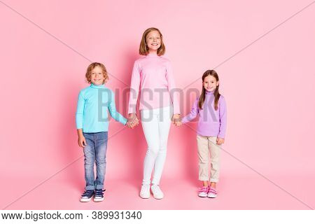 Full Length Photo Of Positive Cheerful Kids Girl Hold Hand Her Brother Sister Enjoy Together Walk Fr