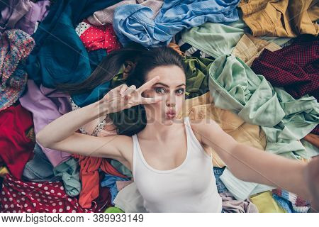 High Angle Above Photo Of Lovely Lady Home Spring Cleaning Lying Many Clothes Stack Floor Prepared U