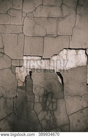Aged Cement Wall Texture. Cracked Concrete Wall Covered With Gray Cement Surface As Background. Crac