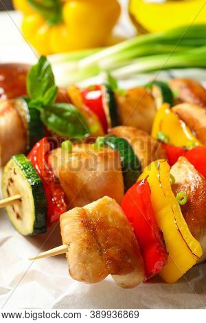 Delicious Chicken Shish Kebabs With Vegetables On Parchment, Closeup