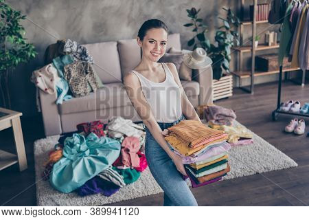 Photo Of Pretty Charming Lady Stay Home Quarantine Sorting Tidy Clean Clothes Hold Hands Stack Wardr