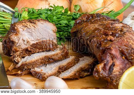 Homemade Roasted Pork Loin With Spices On Wooden Board