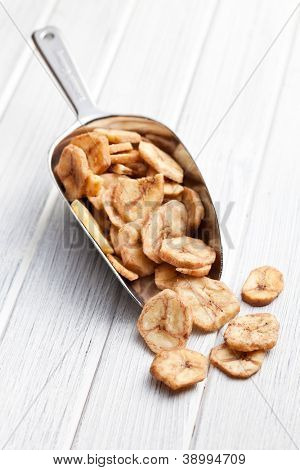dried banana chips in metal scoop