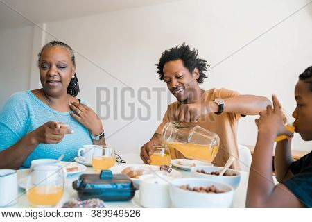 Portrait Of African American Family Having Lunch Together At Home. Family And Lifestyle Concept.