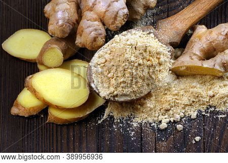 Fresh Ginger Root And Dry Ground Ginger In A Wooden Spoon. Powder Ginger Close-up