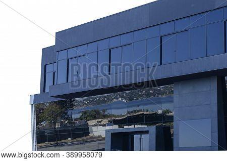 Futuristic Modern Building Clad In Black Glass. Isolate On White Ackground. Contemporary Architectur
