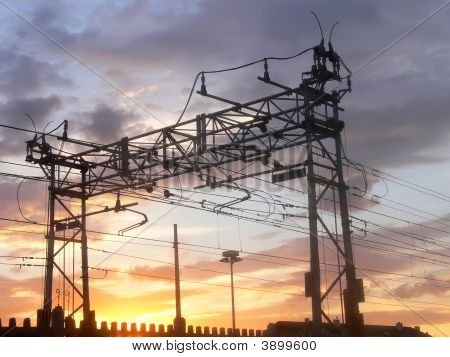 Railway Power Line At Sunset