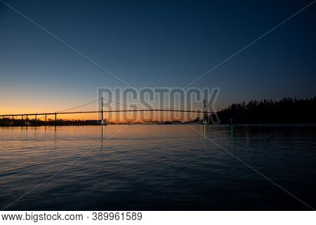 A Picture Of The Lions Gate Bridge At Daybreak. Vancouver Bc Canada