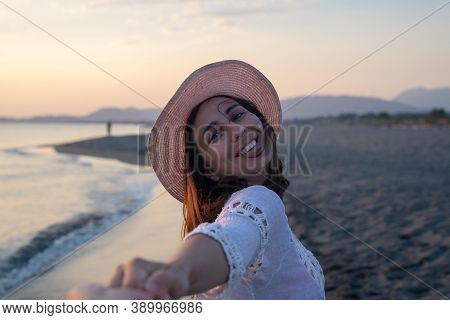 Beautiful Woman Smiling On Beach. People In Vacation Lifestyle. Woman Smiling In Sunset While Holdin