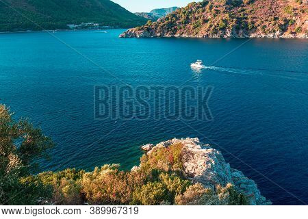 Aerial View Rocks, Waves And Small Boat. Summer Landscape With Sea And Mountain Range. Sea Aerial Vi