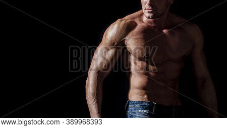 Muscular Torso Close Up. Muscular Sexy Man With Torso. Muscular Model Sports Young Man On Dark Backg
