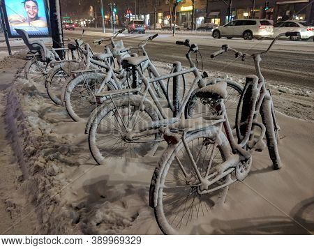 Sweden, Stockholm - February 01 2019: The View Of Bikes Rack In The Snow At The Roadside On February