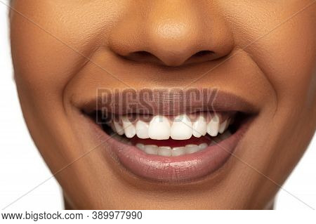 Smile With White Teeth. Close Up Of Female Lips With Nude Make Up. Beautiful African-american Model.